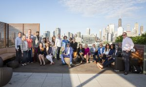 Groupon GREAT leadership group with Chicago skyline.